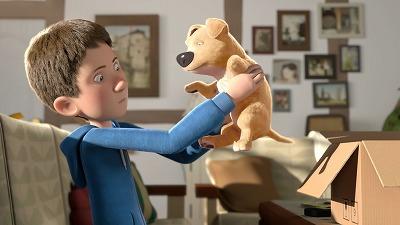 子犬をじっとみる男の子